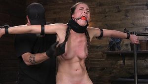 Brunette bound in device pussy caned