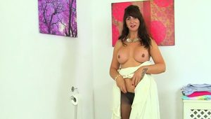 Scottish milf Toni Lace fucks a cucumber in bathroom
