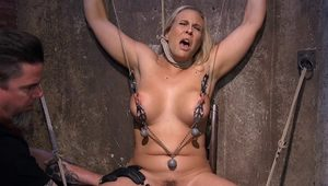 Busty Milf tormented in dungeon
