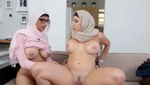 Two stunning Arab women shared a hard cock on the couch