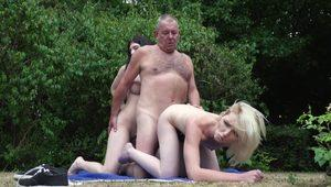 Two young hotties please lucky oldman in the woods in threesome