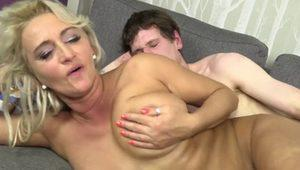 Mature blonde fucked on the couch