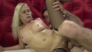 A sex hungry granny with white hair fucked in black stockings