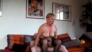 Big breasted wife in stockings goes wild on a throbbing pole