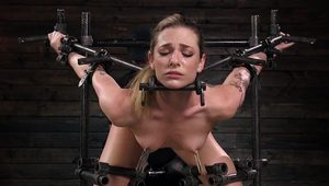 Brunette pussy vibed in device bondage